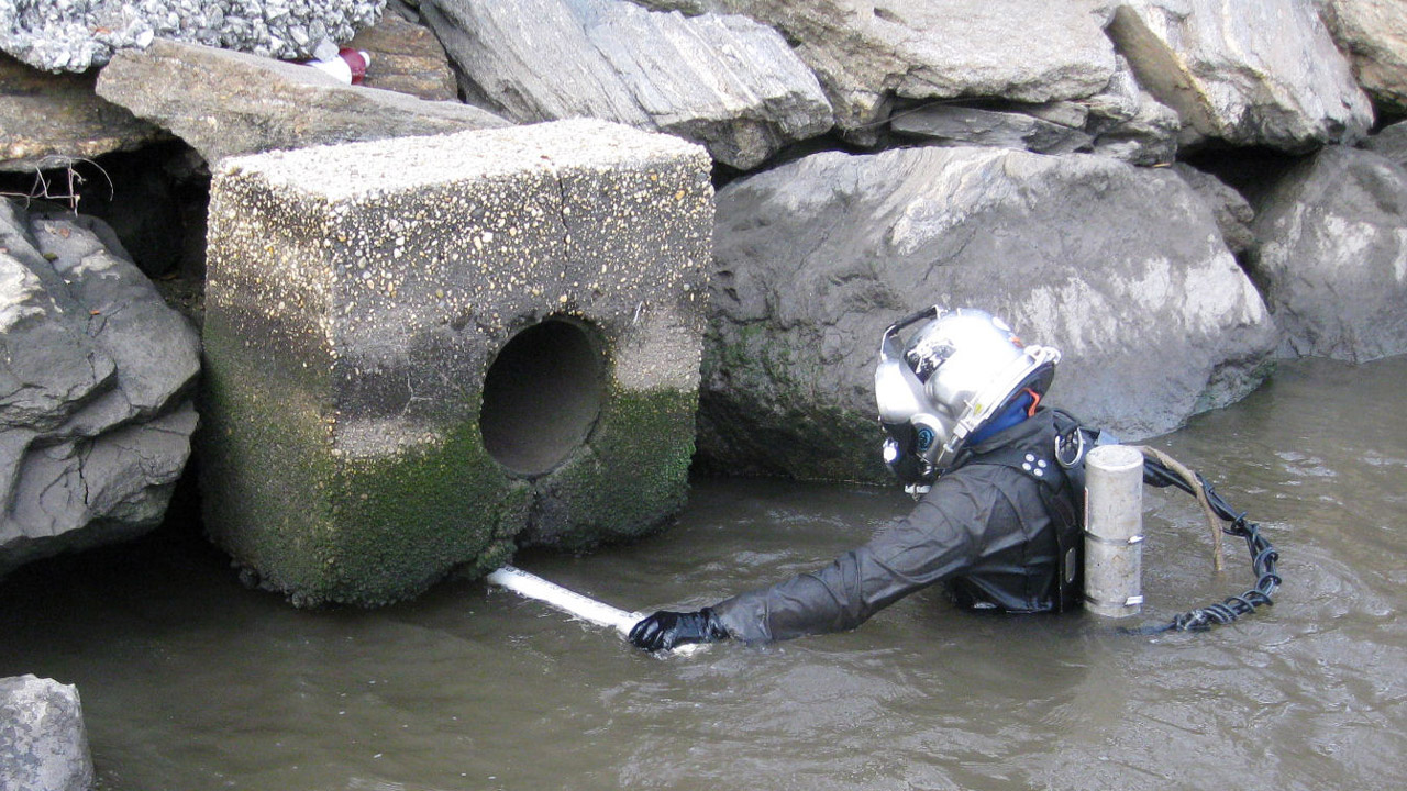 Diver Probing Undermined Sector 7 Outfall Headwall